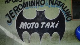 Motorcycle taxi bearing the official trademark of the Justice League.